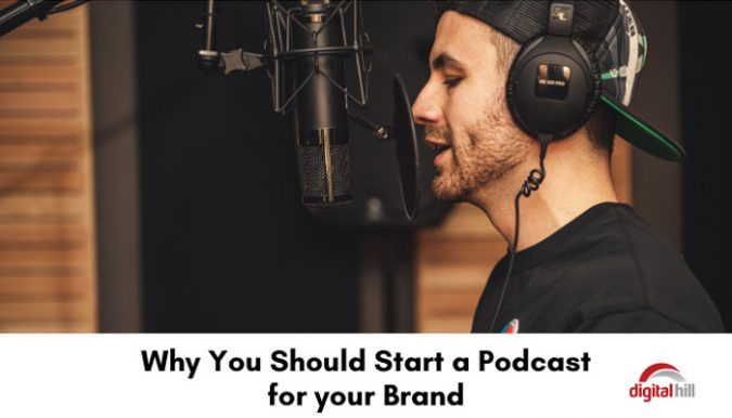 Young male business owner podcasting.